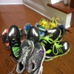 Just a few of the running shoes around our house these days!