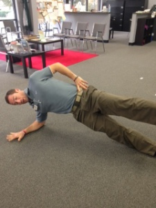 Joe showing me side plank with hip abductor...remember to keep pelvis still.
